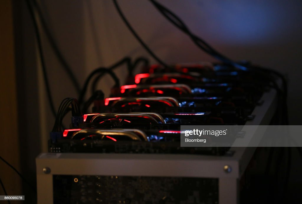 Cryptocurrency mining machines sit in operating racks at the home of Dmitry Gutov, a Russian cryptocurrency 'miner,' in Krasnogorsk, Russia, on Thursday, Sept. 7, 2017. Gutov, who works in a Moscow-based staff-outsourcing firm by day, is among a growing number of Russians who have embraced mining as the price of cryptocurrencies such as bitcoin and ether has soared. Photographer: Andrey Rudakov/Bloomberg via Getty Images