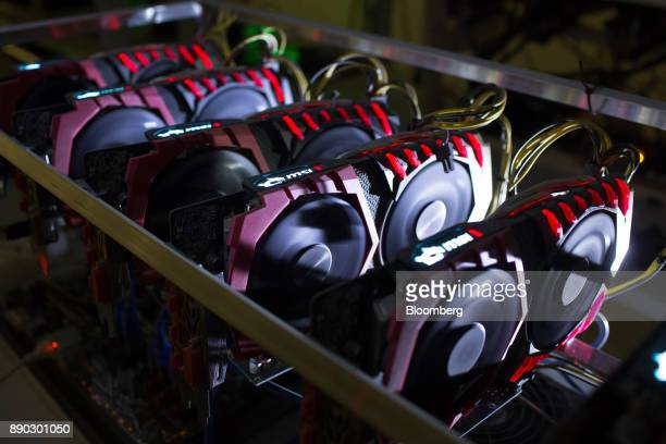 A cryptocurrency mining rig composed of Asus Strix machines operates at the SberBit mining 'hotel' in Moscow Russia on Saturday Dec 9 2017 Futureson...