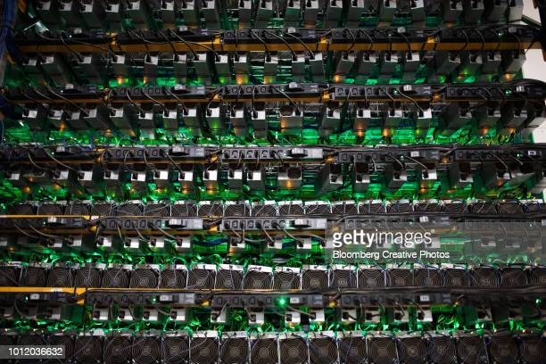 cryptocurrency mining rigs sit on racks at a facility - 仮想通貨マイニング ストックフォトと画像