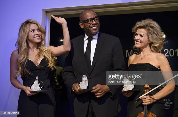 Crystal Award recipients Colombian singer Shakira US actor Forest Whitaker and Germanborn violinist AnneSophie Mutter pose after the Crystal Award...