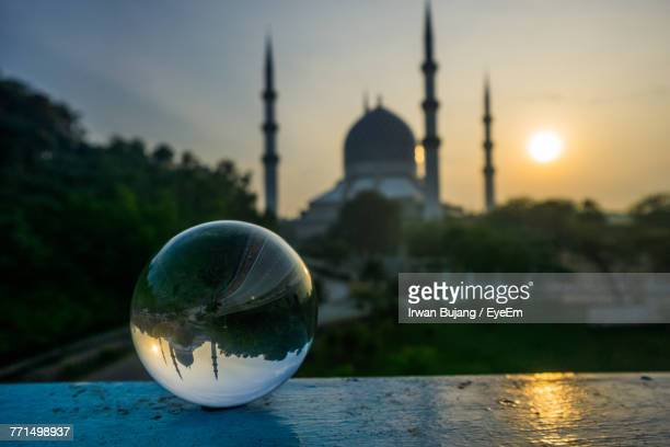 Crystal Ball Against Mosque During Sunset
