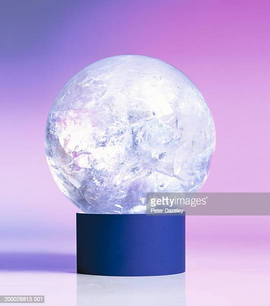 Crystal ball balancing on stand, close-up