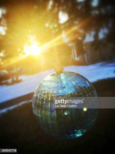 Crystal Ball Hanging In Park During Sunset
