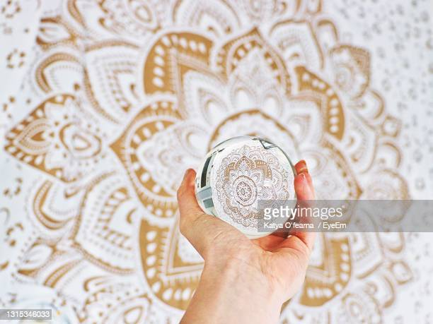 crystal ball mandala white gold with hand - white gold stock pictures, royalty-free photos & images