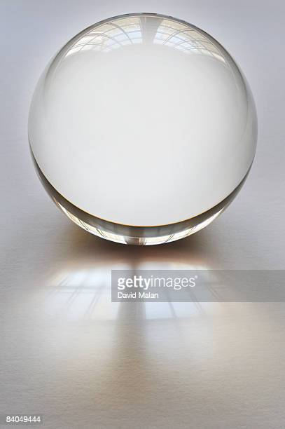 Crystal ball on white surface