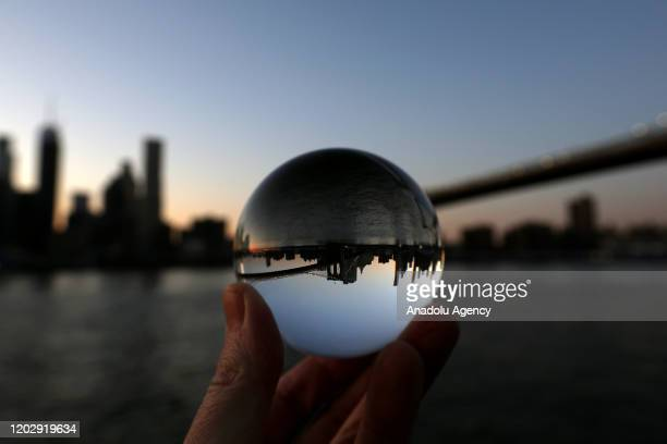 Crystal ball with Brooklyn Bridge seen during sunset from Brooklyn, New York in United States on February 23, 2020.