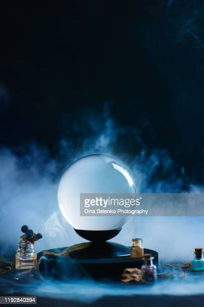 crystal ball with occult equipment and mysterious smoke. fortune-telling concept with copy space - aparición acontecimiento fotografías e imágenes de stock