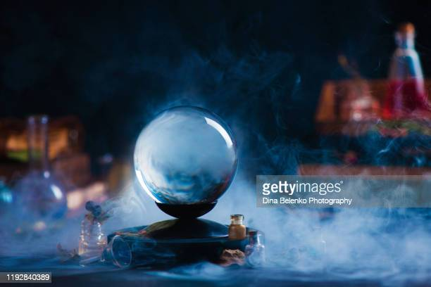 crystal ball with occult equipment and mysterious smoke. magical header with copy space - paranormal stock pictures, royalty-free photos & images
