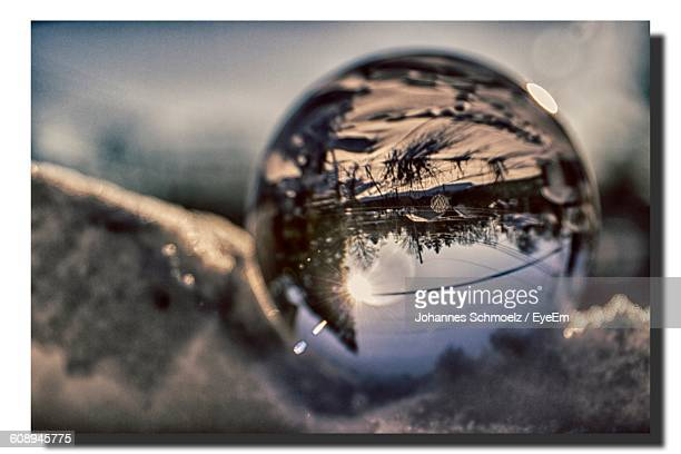 Crystal Ball With Reflection On Snow