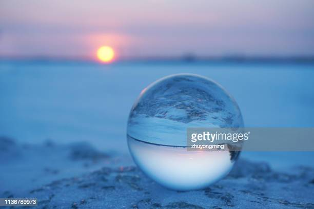 crystal ball,sunset - harbin winter stock pictures, royalty-free photos & images