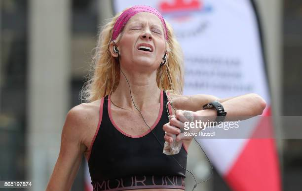 TORONTO ON OCTOBER 22 Crystal Barton of the USA reacts as she crosses the finish line during the Scotiabank Toronto Waterfront Marathon in Toronto...