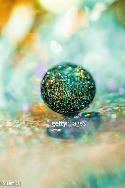 crystal button on bokeh background - button sewing item stock pictures, royalty-free photos & images
