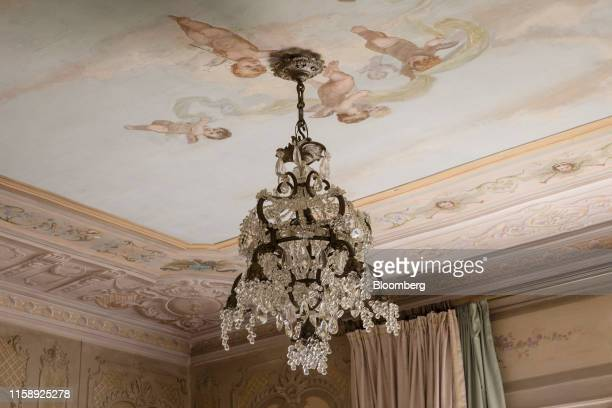 A crystal chandelier hangs from the ceiling of a bedroom inside the Villa Les Cedres a 187yearold000squarefoot 14bedroom mansion set on 35 acres in...