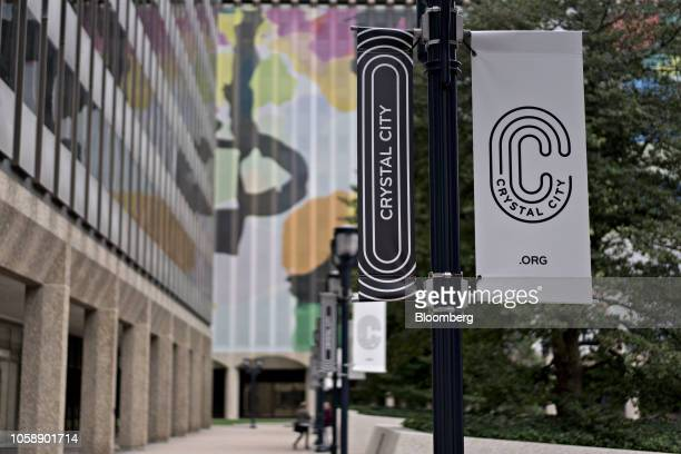 Crystal City signage hangs in Arlington Virginia US on Wednesday Nov 7 2018 Seattlebased Amazon Inc is close to agreements that would split a planned...