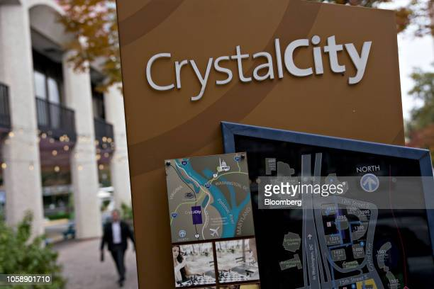 Crystal City signage stands in Arlington Virginia US on Wednesday Nov 7 2018 Seattlebased Amazon Inc is close to agreements that would split a...