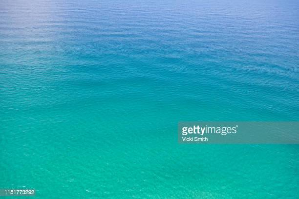 crystal clear blue ocean waters - crystal smith stock pictures, royalty-free photos & images