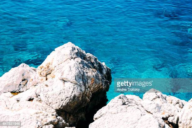 Crystal clear blue water and rocky coastline of the Mediterranean Sea, Montenegro