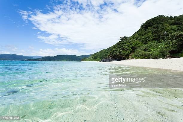 Crystal clear tropical water and deserted beach