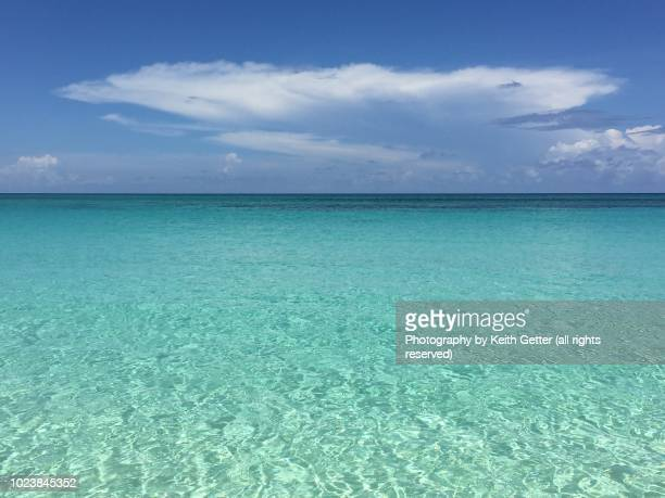 crystal clear turquoise water under a blue sky-favorite beach: paradise island, bahamas - turquoise colored stock pictures, royalty-free photos & images