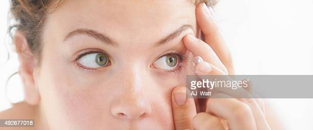 crystal clear vision thanks to my contact lense - contacts stock photos and pictures