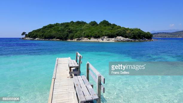crystal clear waters of ksamil, albanian rivièra, albania - albania stock photos and pictures