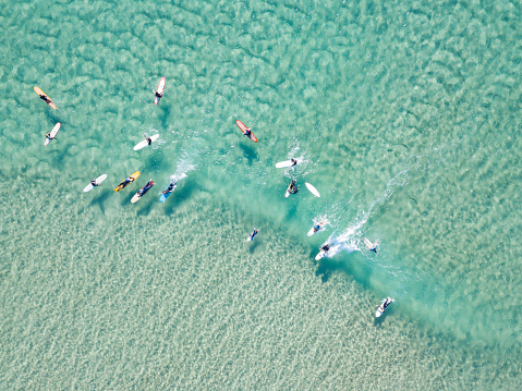 crystal clear waters with surfers seen from above - gettyimageskorea