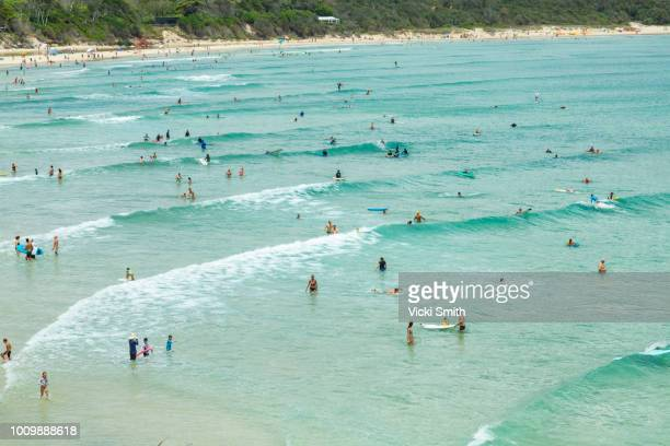 crystal clear waters with swimmers seen from above