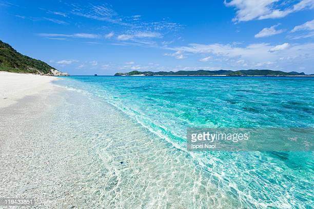 Crystal clear waves, tropical island beach, Japan
