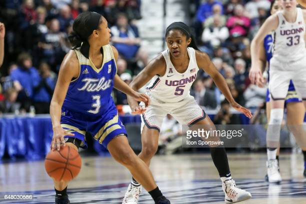 Crystal Dangerfield for UConn defends against Erika Wakefield of Tulsa during the quarterfinal game of the AAC Women's Basketball Championship...