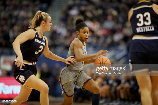 Crystal Dangerfield of the Connecticut Huskies defended by Marina Mabrey of the Notre Dame Fighting Irish during the the UConn Huskies Vs Notre Dame...