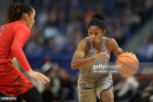 Crystal Dangerfield of the Connecticut Huskies drives to the basket defended by Blair Watson of the Maryland Terrapins during the the UConn Huskies...