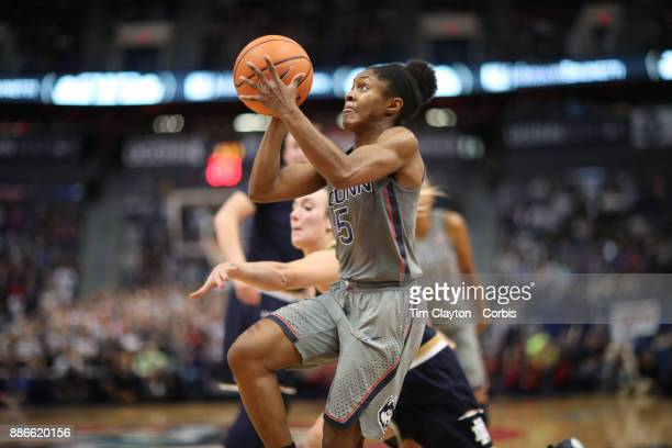 Crystal Dangerfield of the Connecticut Huskies drives to the basket during the the UConn Huskies Vs Notre Dame NCAA Women's Basketball game at the XL...