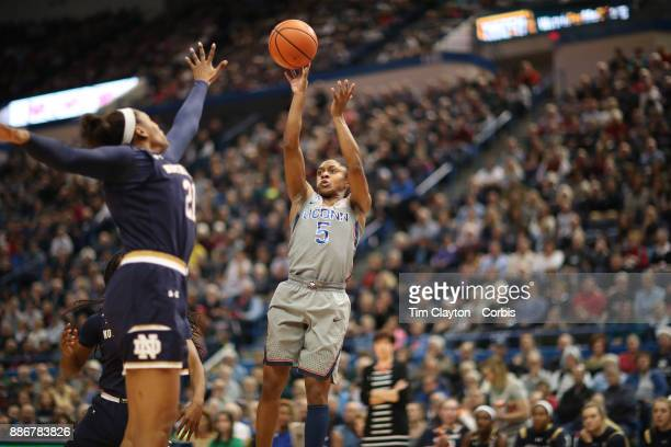 Crystal Dangerfield of the Connecticut Huskies shoots while defended by Kristina Nelson of the Notre Dame Fighting Irish during the the UConn Huskies...