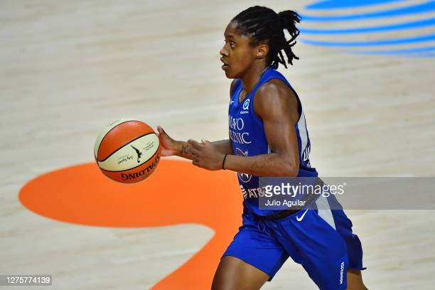 Crystal Dangerfield of the Minnesota Lynx dribbles during the second half against the Seattle Storm in Game One of their Third Round playoff at Feld...