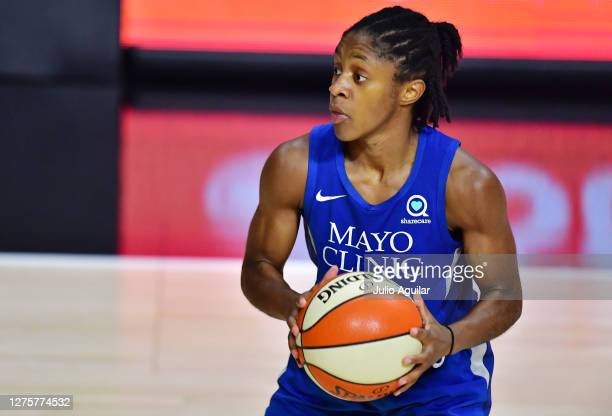 Crystal Dangerfield of the Minnesota Lynx looks to pass during the second half of Game One of their Third Round playoff against the Seattle Storm at...