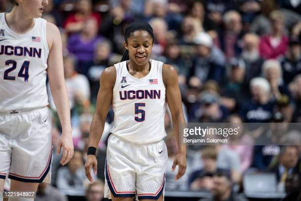 "Crystal Dangerfield of the UConn Huskies during the American Athletic Conference women""u2019s basketball championship at Mohegan Sun Arena on March..."