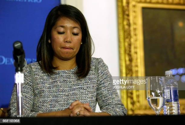 Crystal Dao Pepper attends a news conference for her father Dr David Dao on April 13 2017 in Chicago Illinois Attorneys Stephen Golan and Thomas...