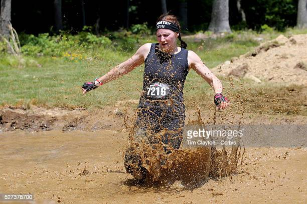 Crystal Desnoyers in action at the mud and water obstacle during the Reebok Spartan Race Mohegan Sun Uncasville Connecticut USA 28th June 2014 Photo...