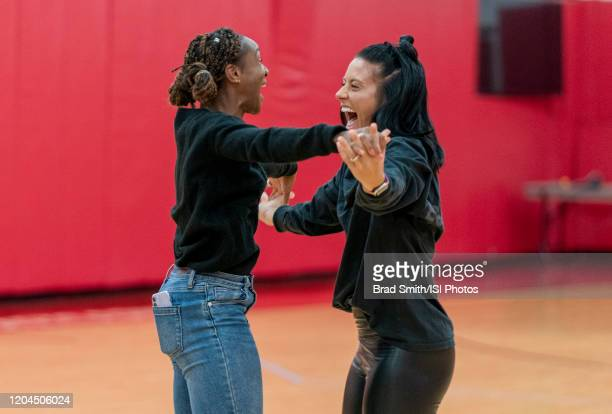 Crystal Dunn and Ali Krieger of the United States celebrate at Houston Rockets Training Center on February 1 2020 in Houston Texas