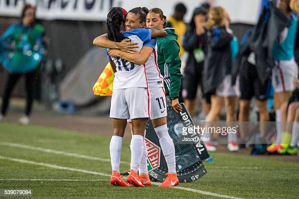 Crystal Dunn and Ali Krieger of the US Women's National Team celebrate as Krieger subs in during the second half of a friendly match against Japan on...