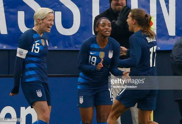 Crystal Dunn and Tobin Heath congratulate teammate Megan Rapinoe after scoring a goal against Englad during the first half of the 2019 SheBelieves...