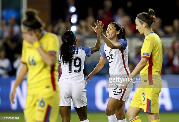 Crystal Dunn congratulates Christen Press of United States of America after she scored against Romania at Avaya Stadium on November 10 2016 in San...