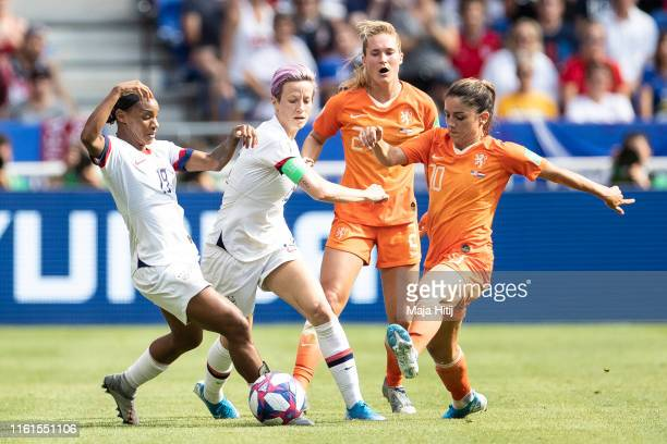 Crystal Dunn , Megan Rapinoe of the USA and Desiree van Lunteren and Danielle van de Donk of the Netherlands battle for possession during the 2019...
