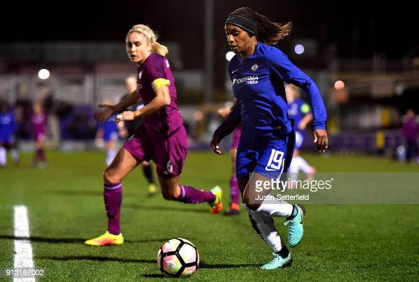 Crystal Dunn of Chelsea Ladies goes past Steph Houghton of Manchester City Ladies during the WSL match between Chelsea Ladies and Manchester City...