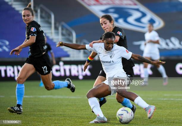 Crystal Dunn of North Carolina Courage fights for the ball against Sabrina Flores of Sky Blue FC during a game on day 8 of the NWSL Challenge Cup at...