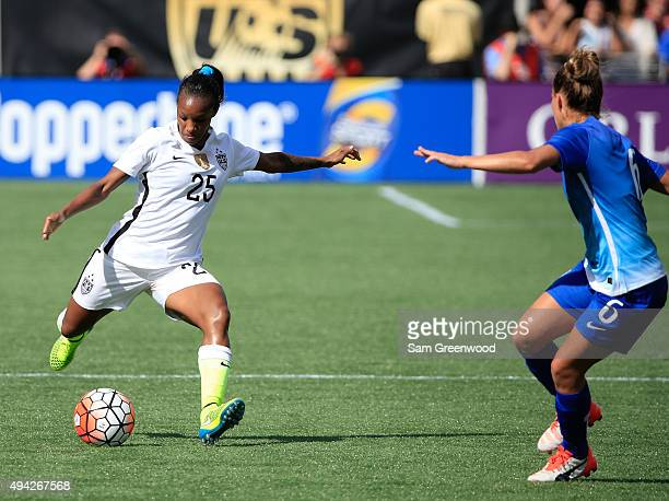 Crystal Dunn of the United States attempts a shot on goal against Tamires of Brazil during a Women's International Friendly soccer match at Orlando...