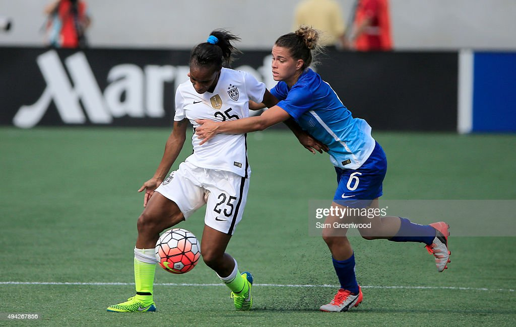Crystal Dunn #25 of the United States attempts to drive past Tamires #6 of Brazil during a Women's International Friendly soccer match at Orlando Citrus Bowl on October 25, 2015 in Orlando, Florida.