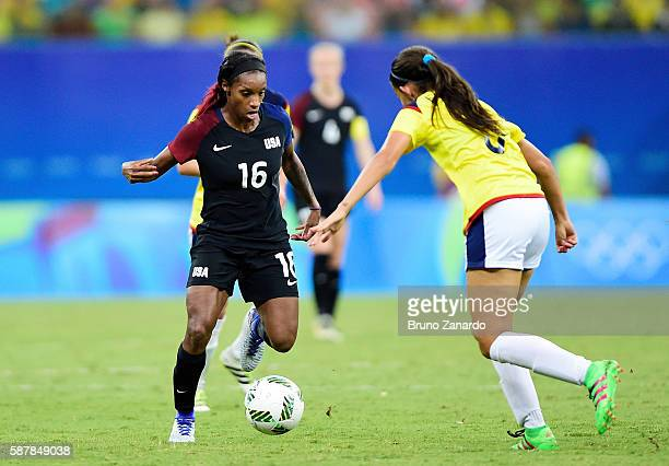 Crystal Dunn of the United States controls the ball against Colombia in the second half of the Women's Football First Round Group G match on Day 4 of...