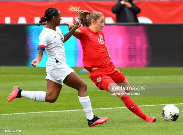 Crystal Dunn of the United States defends a shot on goal by Janine Beckie of Canada in the first half of the CONCACAF Women's Olympic Qualifying...