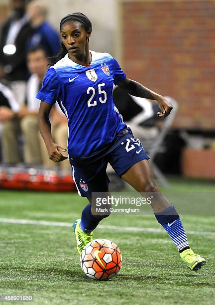 Crystal Dunn of the United States dribbles the ball during the US Women's 2015 World Cup Victory Tour match against Haiti at Ford Field on September...